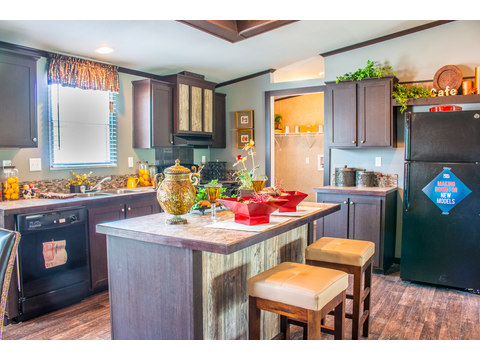 Easy access to utility room from kitchen - the Momentum II MMT348B1 by Palm Harbor Homes