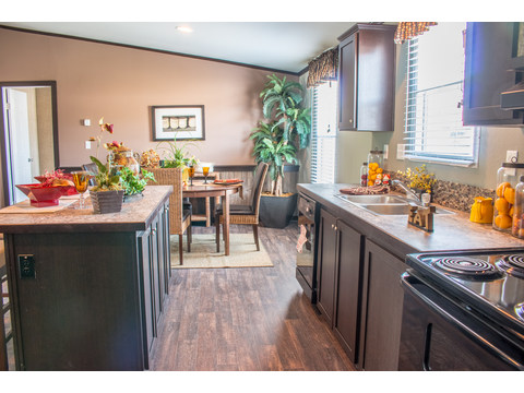 Well-designed work area in spacious galley kitchen with access to the dining area - The Momentum II MMT348B1 or MM32483A manufactured home by Palm Harbor Homes - 3 Bedrooms, 2 Baths, 1,488 Sq. Ft