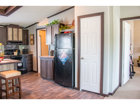 Lovely pantry close to refrigerator in Kitchen - The Momentum II MMT348B1 or MM32483A manufactured home  by Palm Harbor Homes - 3 Bedrooms, 2 Baths, 1,488 Sq. Ft