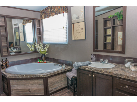 This Masterbath is spacious, well-designed and appointed with lovely design features - The Momentum II MMT348B1 or MM32483A manufactured home exterior by Palm Harbor Homes - 3 Bedrooms, 2 Baths, 1,488 Sq. Ft