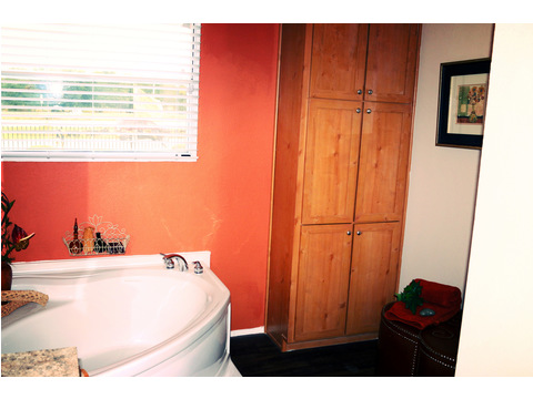 Soak away the days stress in this BIG soaker tub! Look at the large built-in linen cabinet as well!!