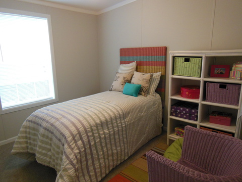 The Guest bedroom in The Ventura TST348E8 by Palm Harbor Homes is perfect for mother-in-laws, grandchildren and more!