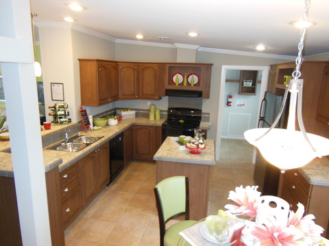 The slightly raised bar area in the Ventura hides clutter and meal prep messes from guests and provides a great place for friends and family to sit and talk with the cook. Notice the large laundry room adjacent.
