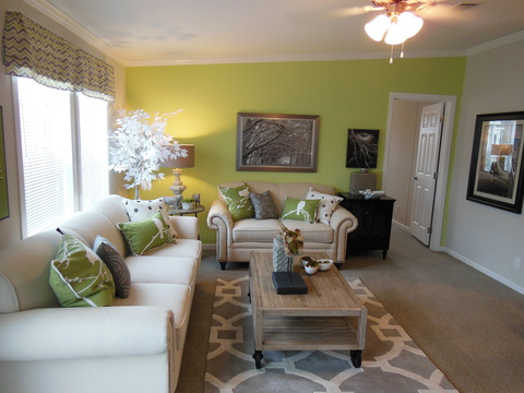 Living room of The Ventura TST348E8 manufactured home by Palm Harbor Homes in Plant City, Florida.  This home is available in Georgia, Florida, Alabama and Mississippi for all wind zones.