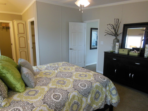 The Master Suite in The Ventura TST348E8 by Palm Harbor Homes has great crown molding, a walk-in closet and a separate potty room and much more!
