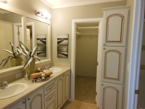 The Master bath in The Ventura TST348E8 by Palm Harbor Homes has a handy linen storage and walk-in closet space for him and her!