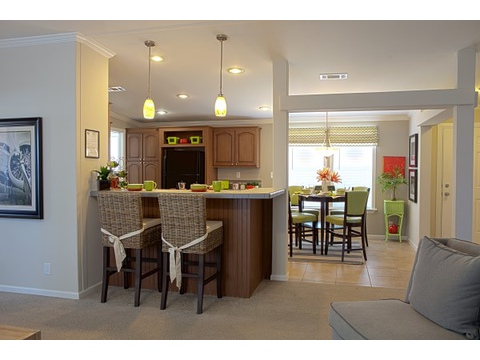 The Ventura's naturally flowing layout makes it live and feel much larger than its 1,429 square feet, with three bedrooms and 2 baths. Open pass throughs provide great site lines through out the house.
