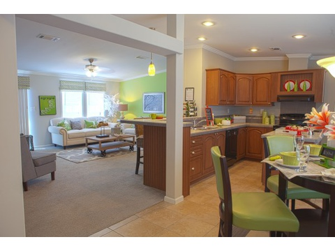 "The Ventura manufactured home by Palm Harbor Homes provides the perfect marriage of ""open living"" with ""don't look at my kitchen""!  The person in the kitchen can easily interact with family and guests, but still has some ""separation"" from the rest."