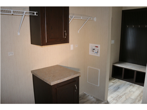 Utility room with built in cabinetry!