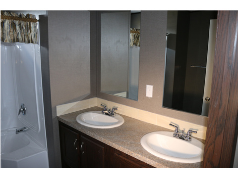 Another shot of the guest bathroom with dual vanities...