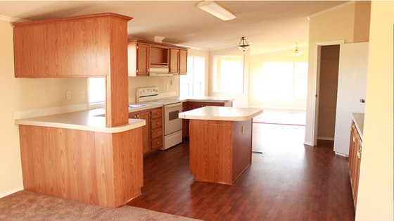 The Kitchen Provides Plenty Of Preparation And Storage Space With A Well Placed Island For Easy Use