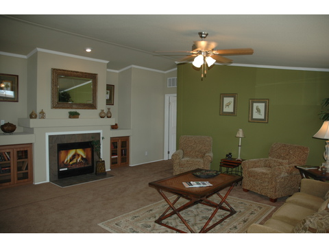 Spacious living room with fireplace and built-in shelving - The Ponderosa SCT476U7 by Palm Harbor Homes