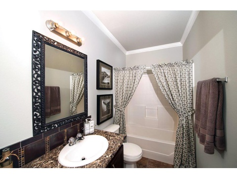 Big spacious secondary bathroom with beautiful cabinets and countertops. Call 1-766-446-3718 to find a Palm Harbor Model Center near you. - The Harbor House III FTP476M1 by Palm Harbor Homes