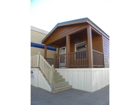 The Cabana IV, as displayed here at the Ft. Worth Stock Show, comes complete with front porch! - Palm Harbor Homes