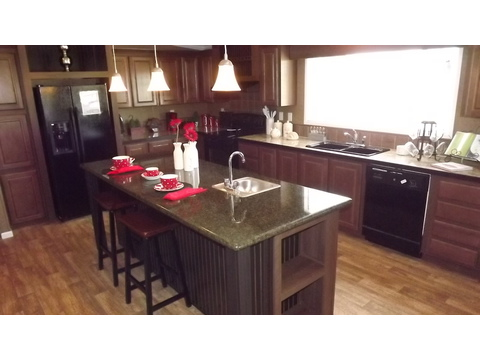 Kitchen with oversized island - The Pecan Valley III - Extra Wide KHV368H1 by Palm Harbor Homes