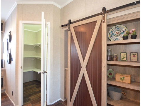 Walk-in pantry and storage with sliding barn door - The Kensington 4 ML30604K by Palm Harbor Homes