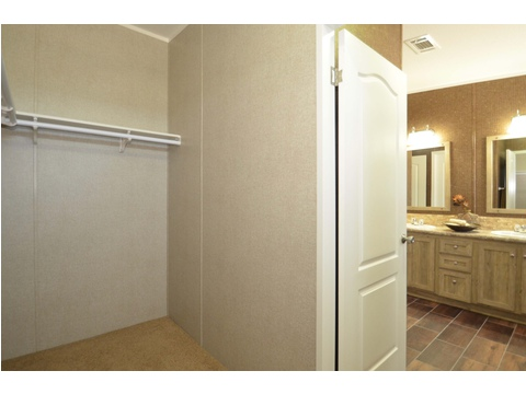 Large walk-in closet in master suite - The Kensington 4 ML30604K by Palm Harbor Homes
