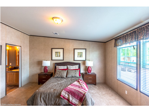 The master bedroom follows the rest of the home - - open and light and roomy -- in the Momentum IV MMT364B1 manufactured home with 3 Bedrooms, 2 Baths, 1,984 Sq. Ft.