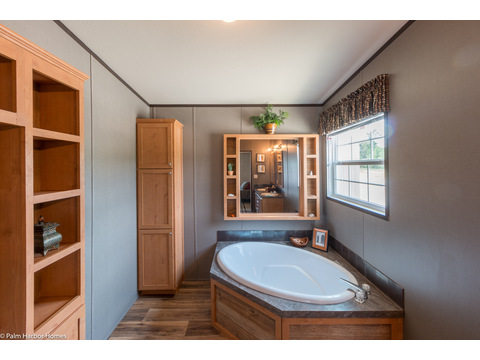 A closer look at the soaker tub and the built-in linen storage in the Momentum IV MMT364B1 manufactured home with 3 Bedrooms, 2 Baths, 1,984 Sq. Ft.