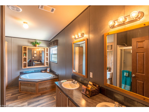 The master bath packs a punch with lots of built-in storage, a large soaker tub, big shower and double sinks in the Momentum IV MMT364B1 manufactured home with 3 Bedrooms, 2 Baths, 1,984 Sq. Ft.