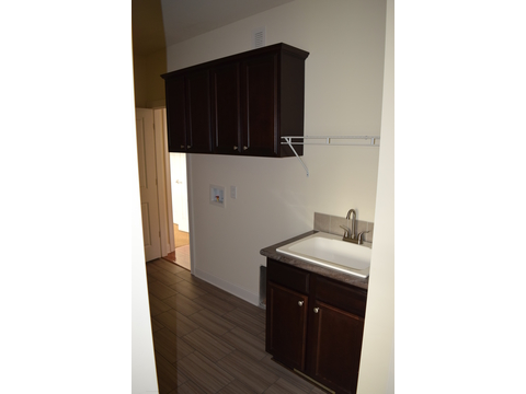 Clean up sink and built in storage about washer & dryer area in The Maiden II - a modular home built by Nationwide Custom Homes in their Palm Harbor Home lineup for the Mid - Atlantic states. 3 Bedrooms, 2.5 Baths, 1,999 Sq. Ft.