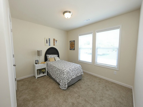 Secondary bedroom 1 in the Drake model - a 4 Bedroom, 2 Bath, 1,882 Sq. Ft. modular Palm Harbor home built by Nationwide Homes