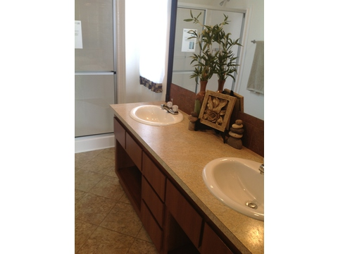 Master bathroom has his and her sinks - The Heritage II LCD2844A