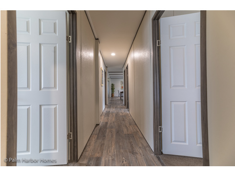 The hallway providing access to the other bedrooms and the Bonus Room.  Velocity by Palm Harbor Homes - 4 Bedrooms, 2 Baths, 1860 Sq. Ft.
