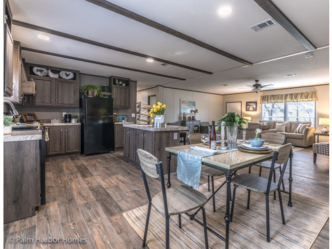A view of the open Kitchen and Dining Room.  Velocity by Palm Harbor Homes - 4 Bedrooms, 2 Baths, 1860 Sq. Ft.
