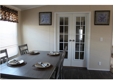 This manufactured home has Double French doors with beautiful glass panes leading to the home office located directly off the dining room. - The Pecan Valley 56 KHP356P5 by Palm Harbor Homes