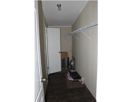The Pecan Valleys master closet provides room for hanging clothes, shoes, and off-season clothes as well. The heavy-duty shelving is included.