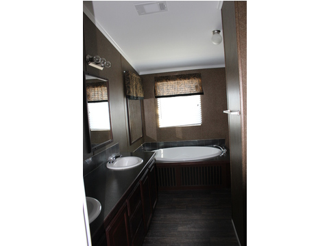 The master bath provides double sinks, huge counter top areas and storage and much more. Check out the great lighting and the soaker tub! Don't miss the tile back splashes... - The Pecan Valley 56 KHP356P5 by Palm Harbor Homes