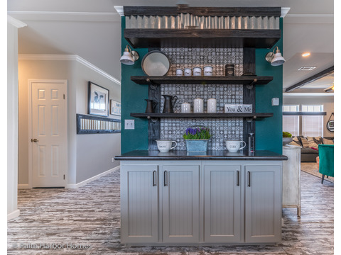 Built-in buffet in the Vintage Farmhouse Model FT32643C with 3 Bedrooms, 2 Baths and 1,984 Sq. Ft. Exterior Dimensions: 31 x 64. Other layouts available from Palm Harbor Homes.  See Floor plan options.