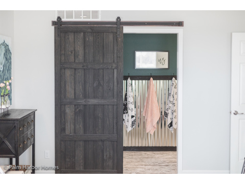 Door from Master bedroom to master bath in the Vintage Farmhouse Model FT32643C with 3 Bedrooms, 2 Baths and 1,984 Sq. Ft. Exterior Dimensions: 31 x 64. Other layouts available from Palm Harbor Homes.  See Floor plan options.
