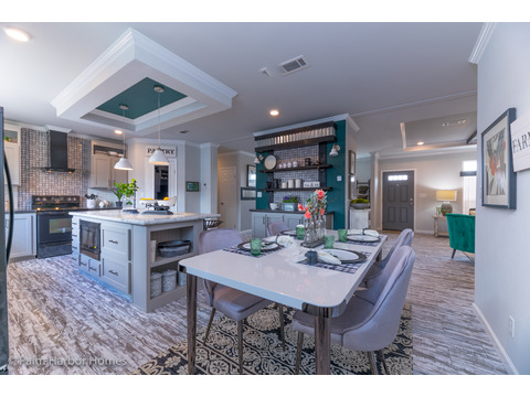 Informal dining area and kitchen in the Vintage Farmhouse Model FT32643C with 3 Bedrooms, 2 Baths and 1,984 Sq. Ft. Exterior Dimensions: 31 x 64. Other layouts available from Palm Harbor Homes.  See Floor plan options.