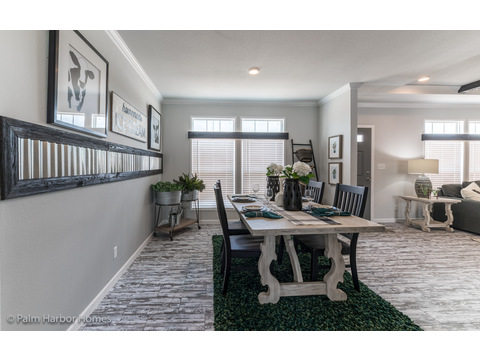 From the kitchen to the dining area in the Vintage Farmhouse Model FT32643C with 3 Bedrooms, 2 Baths and 1,984 Sq. Ft. Exterior Dimensions: 31 x 64. Other layouts available from Palm Harbor Homes.  See Floor plan options.