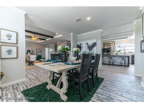 Dining area has great access in the Vintage Farmhouse Model FT32643C with 3 Bedrooms, 2 Baths and 1,984 Sq. Ft. Exterior Dimensions: 31 x 64. Other layouts available from Palm Harbor Homes.  See Floor plan options.