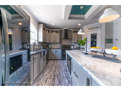 Kitchen island in the Vintage Farmhouse Model FT32643C with 3 Bedrooms, 2 Baths and 1,984 Sq. Ft. Exterior Dimensions: 31 x 64. Other layouts available from Palm Harbor Homes.  See Floor plan options.