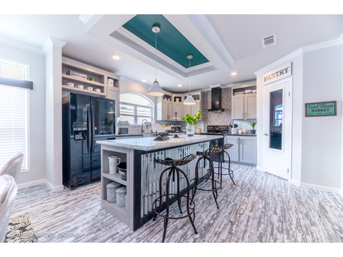 Kitchen in the Vintage Farmhouse Model FT32643C with 3 Bedrooms, 2 Baths and 1,984 Sq. Ft. Exterior Dimensions: 31 x 64. Other layouts available from Palm Harbor Homes.  See Floor plan options.