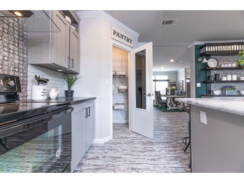 Walk in Pantry in the Vintage Farmhouse Model FT32643C with 3 Bedrooms, 2 Baths and 1,984 Sq. Ft. Exterior Dimensions: 31 x 64. Other layouts available from Palm Harbor Homes.  See Floor plan options.