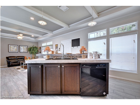 Kitchen island with living room in the background - The Grand Haven FF16763H by Palm Harbor Homes