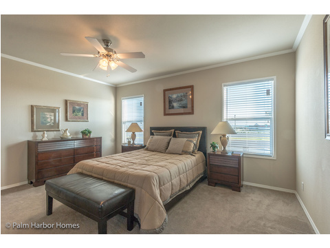 The master bedroom is spacious enough for a king or a queen bed.  And there is a HUGE walk-in closed and a large on suite bathroom to complete this master retreat. - The Harbor House FTP360M6 Palm Harbor Homes