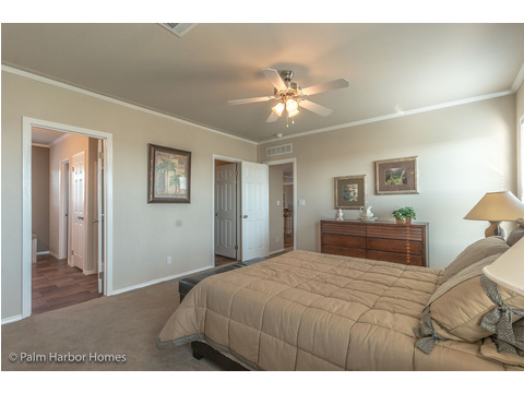 The master bedroom in the Harbor House has a large closet and a great master bath. - The Harbor House FTP360M6 Palm Harbor Homes