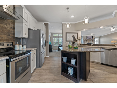 Hacienda III Kitchen off Family Room by Palm Harbor Homes - 4 Bedrooms, 3.5 Baths, 3,012 Sq. Ft.