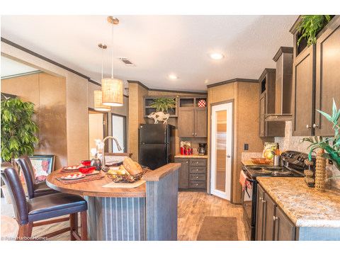 Nothing is more than a step away in this kitchen in the Homeland model ML30483H manufactured home by Palm Harbor Homes with 3 Bedrooms, 2 Baths, 1,440 Sq. Ft
