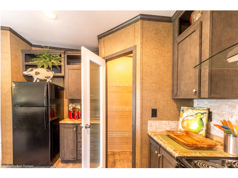 Nice-sized walk-in pantry in kitchen in the Homeland model ML30483H manufactured home by Palm Harbor Homes with 3 Bedrooms, 2 Baths, 1,440 Sq. Ft