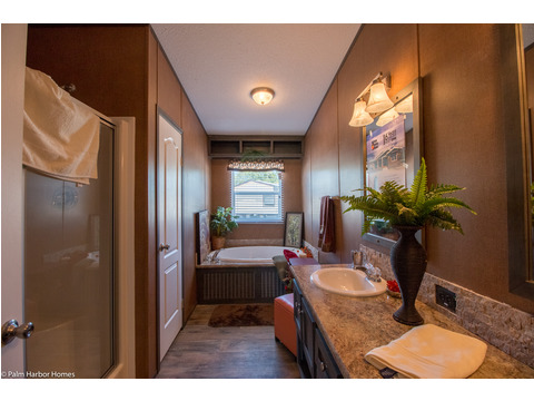 The Homeland master bath has it all! Full walk-in shower, giant soaker garden tub and separate commode room! Check out the Homeland model ML30483H manufactured home by Palm Harbor Homes with 3 Bedrooms, 2 Baths, 1,440 Sq. Ft