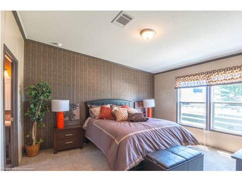 You get plenty of space in the master bedroom of the Homeland model ML30483H manufactured home by Palm Harbor Homes with 3 Bedrooms, 2 Baths, 1,440 Sq. Ft