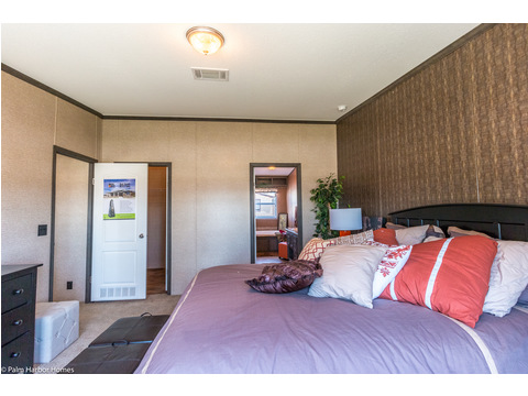 Walk-in closet, bathroom with full walk-in shower and garden tub - it's all here in the master suite in the Homeland model ML30483H manufactured home by Palm Harbor Homes with 3 Bedrooms, 2 Baths, 1,440 Sq. Ft