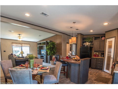 The dining area and the kitchen are in close proximity to the living room and the guest area in the Homeland model ML30483H manufactured home by Palm Harbor Homes with 3 Bedrooms, 2 Baths, 1,440 Sq. Ft